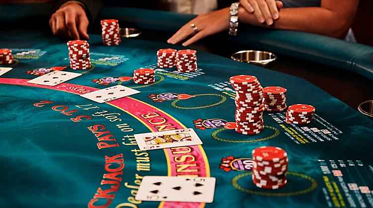Description: blackjack-table-card-game-players-and-chips-onboard-things-to-do-casino